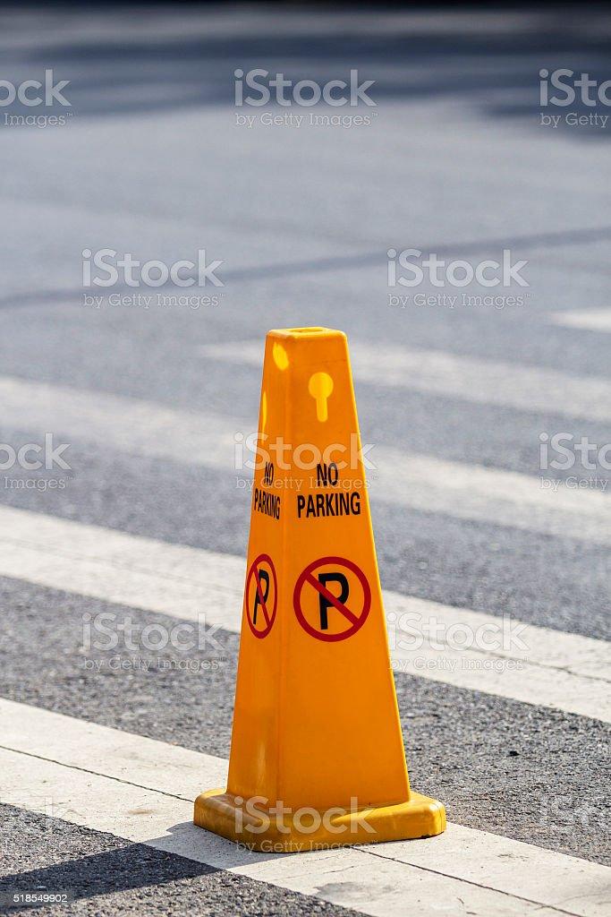 no parking pillar on zebra crossing stock photo