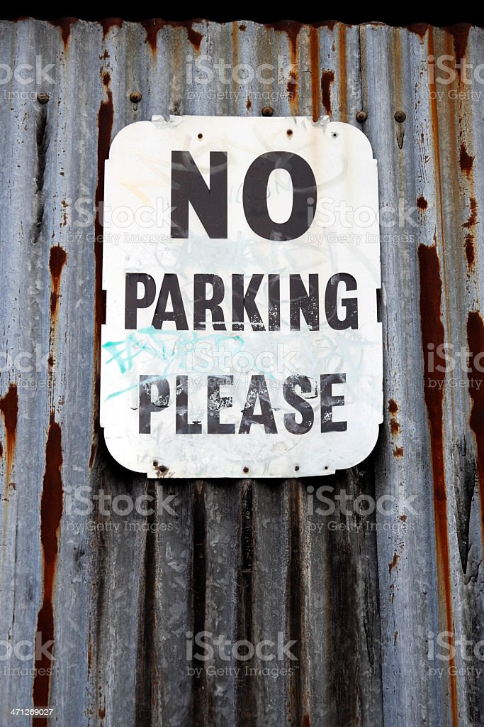 No Parking Please sign on corrugated iron fence royalty-free stock photo
