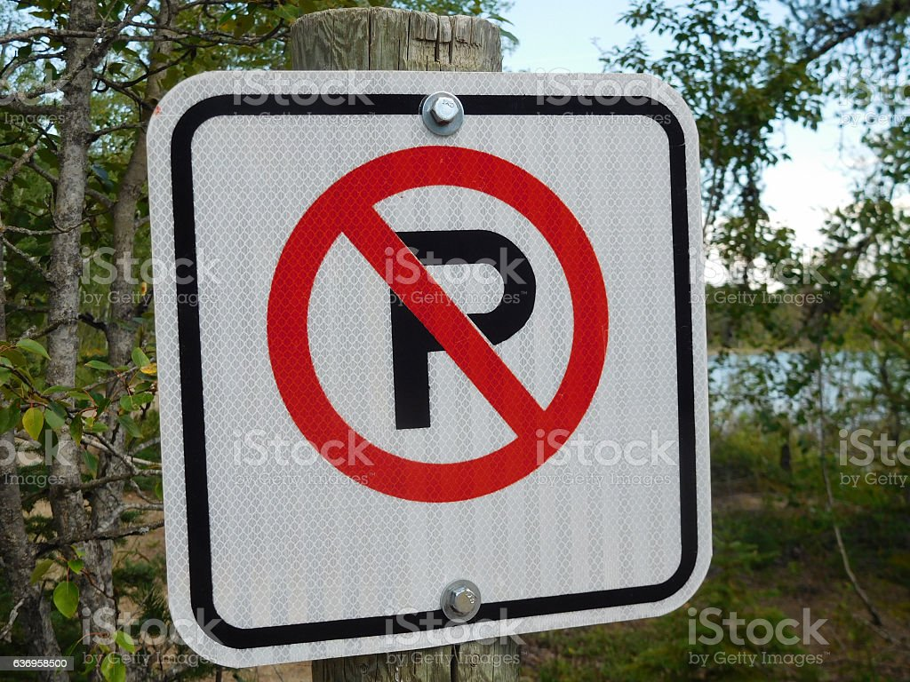 No Parking Sign Against a Forest Background stock photo