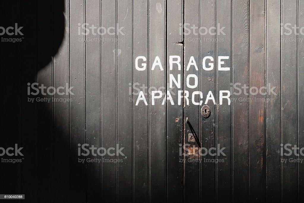 No Parking Sign, Old Locked Garage Door Shade, Mallorca, Spain stock photo