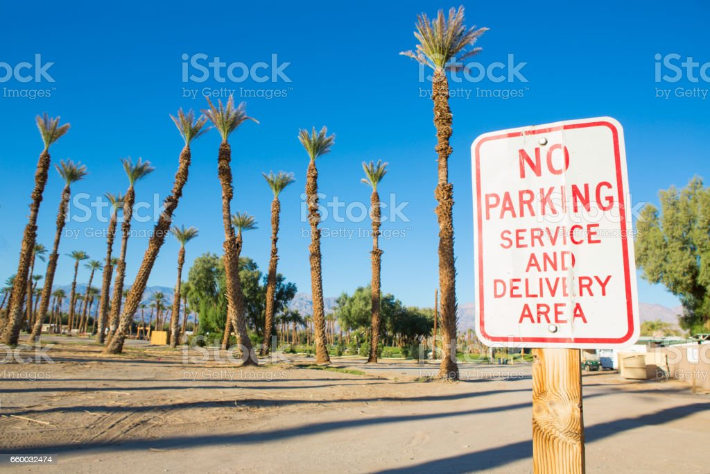 No Parking sign with palm trees stock photo