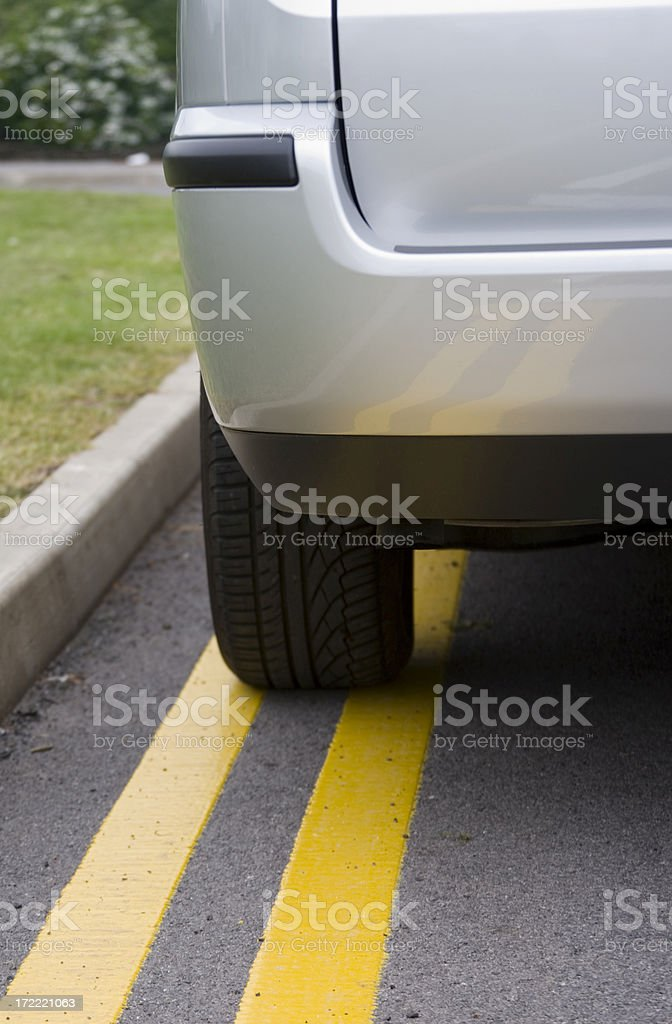 No Parking - Silver Car in Portrait Format stock photo