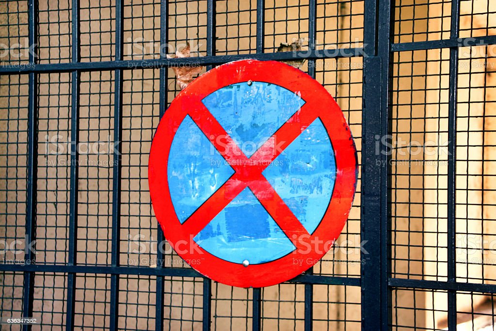 No parking traffic sign over iron gate network background stock photo