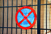 No parking traffic sign over iron gate network background