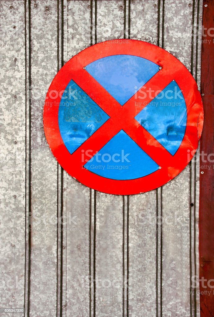 No parking traffic sign over old iron background stock photo