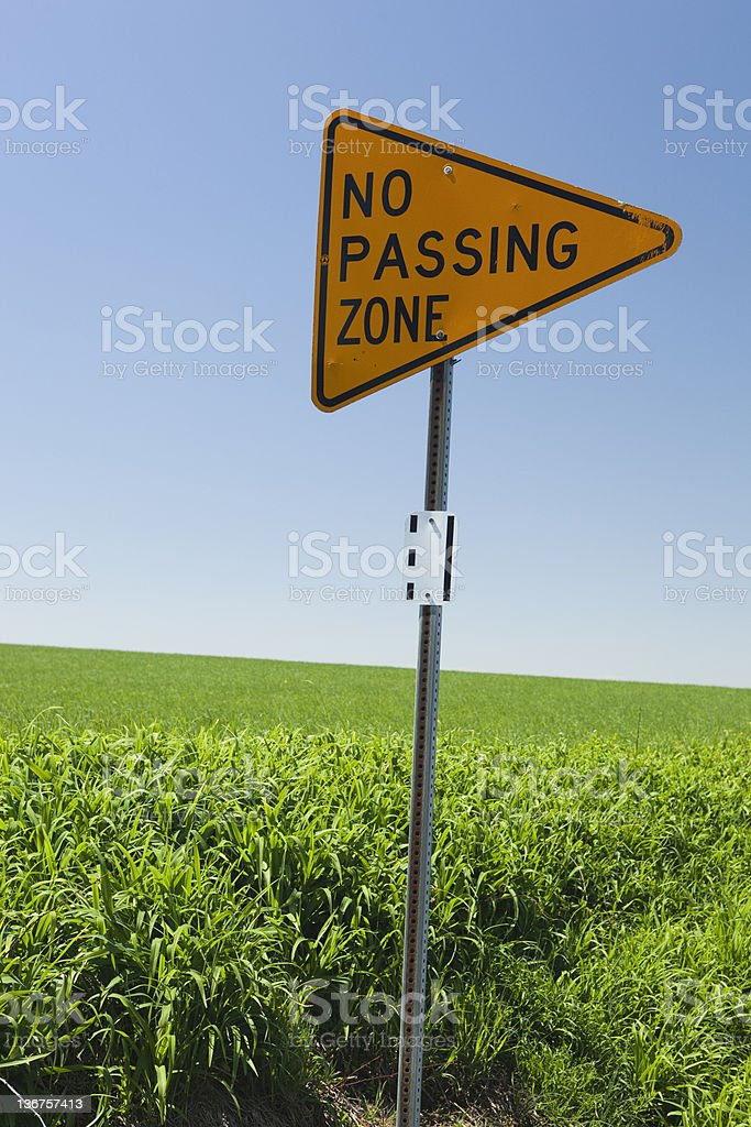 No passing zone signage alongside a road stock photo