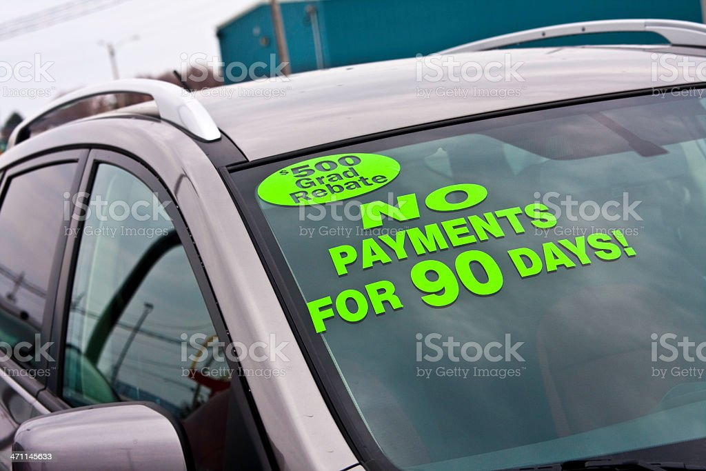 No Payments for 90 Days Decal on Car Windshield stock photo