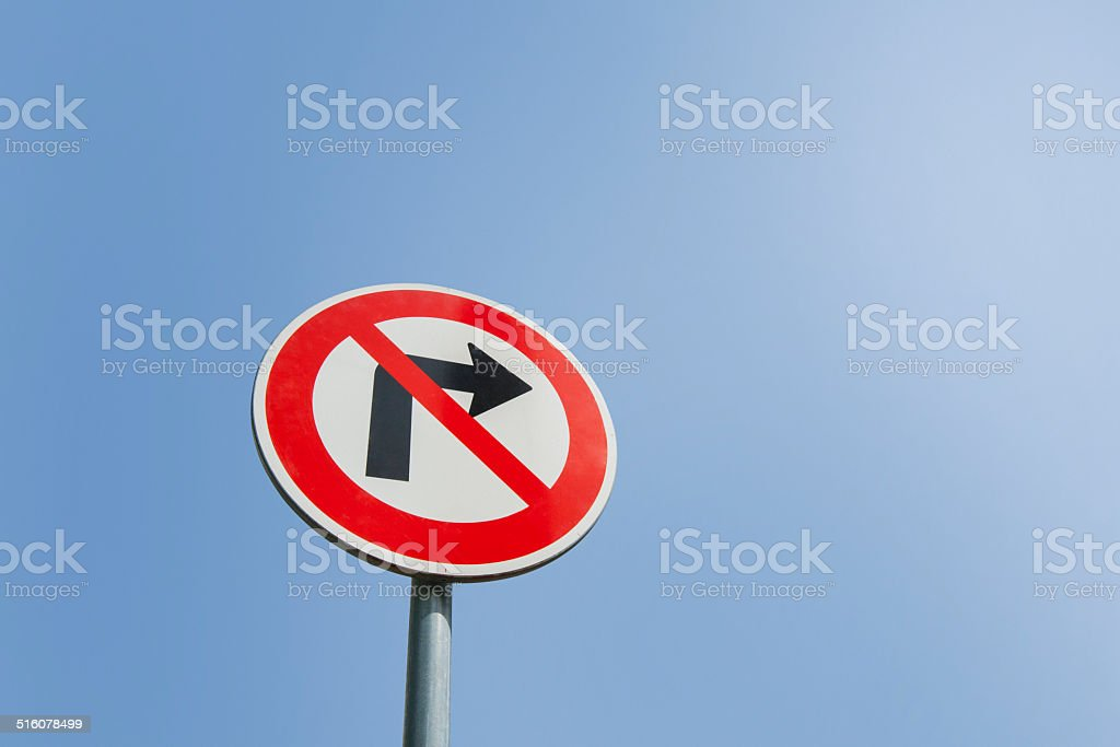 No right turn sign against clear sky stock photo