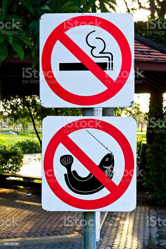 no smoking and fishing warning sign stock photo