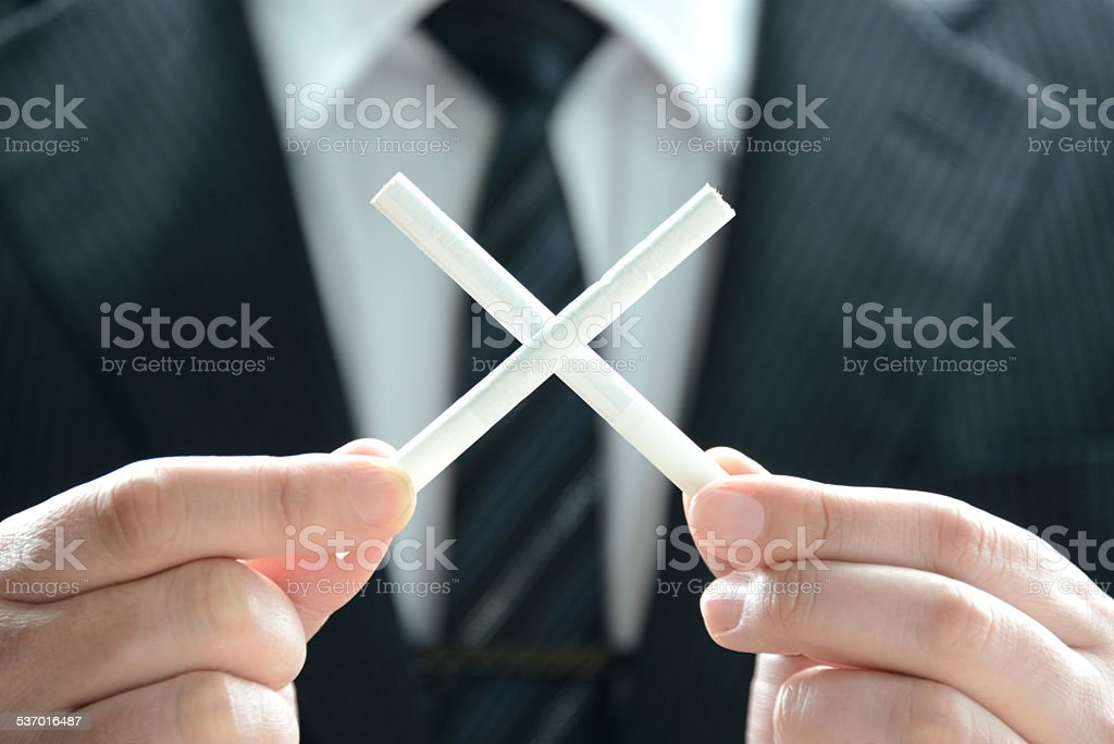 No Smoking by business person stock photo