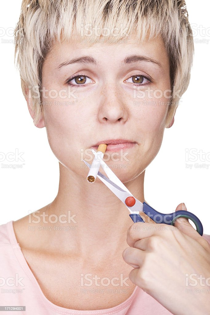 No smoking concept. Young woman breaking cigarette stock photo