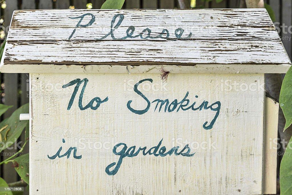 'No smoking in gardens' sign royalty-free stock photo