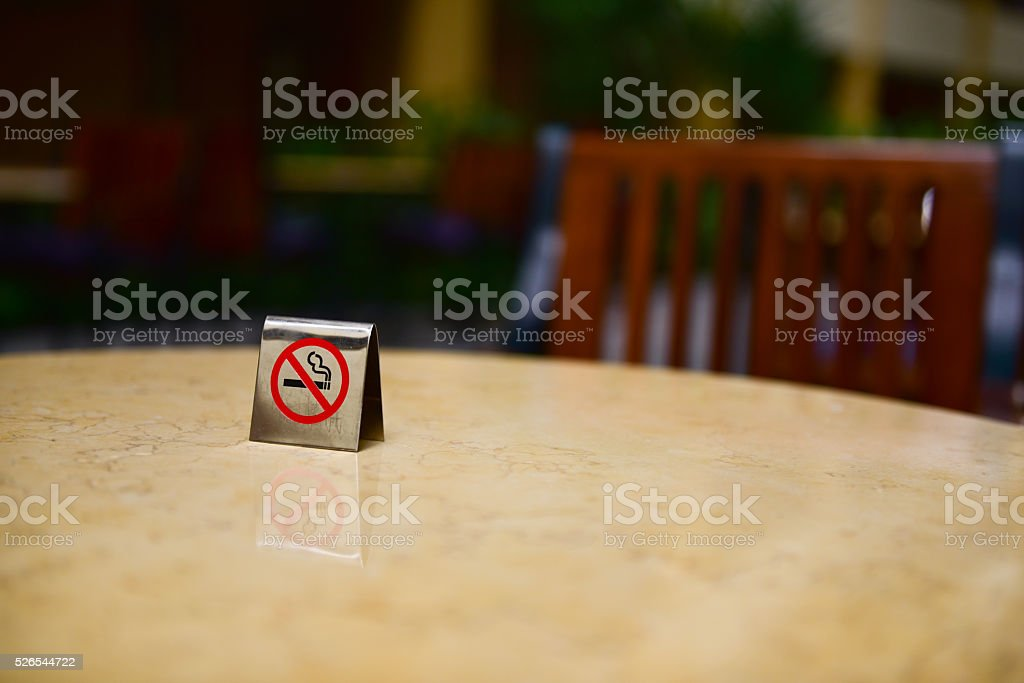 No smoking sign at table stock photo