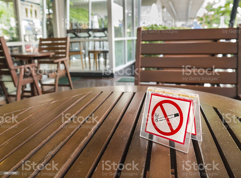 no smoking sign displayed on a table stock photo