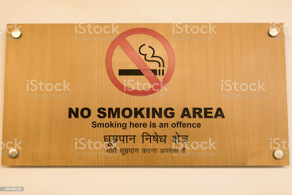 No Smoking Sign in Indic Script and English stock photo