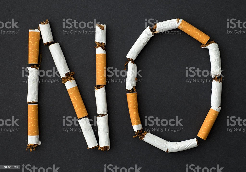 No smoking sign made with broken cigarettes stock photo