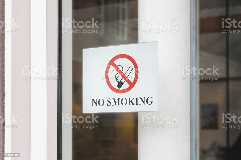No smoking sign on a window glass stock photo