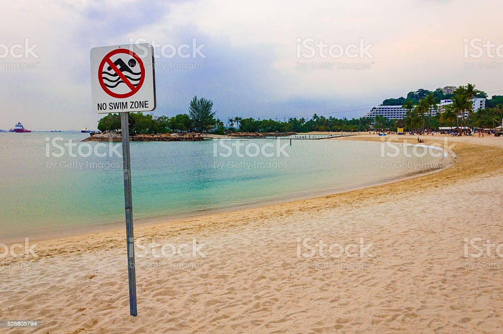 no swim zone sign at the beach stock photo
