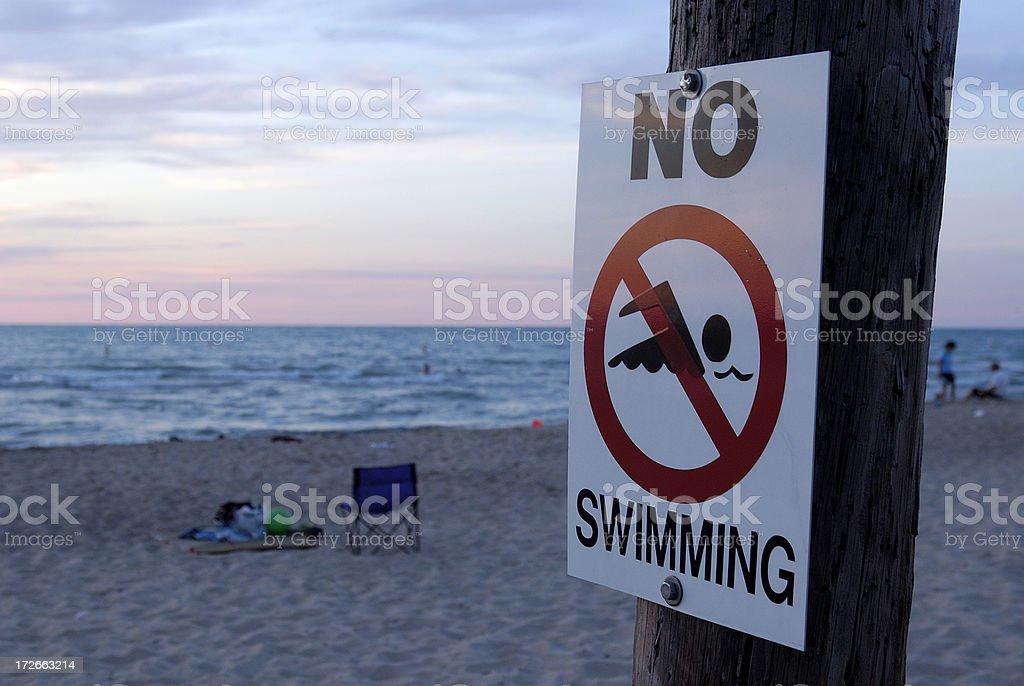 No swimming sign on lake michigan beach stock photo