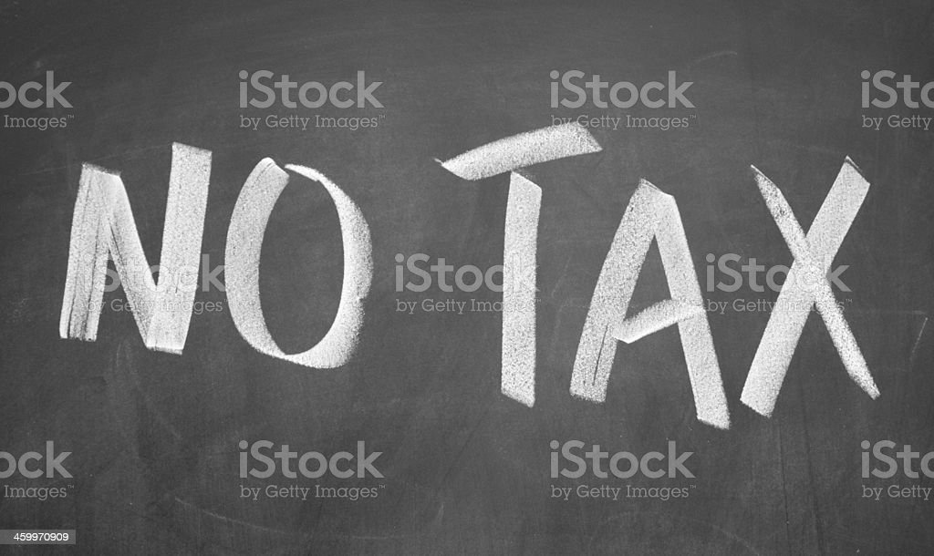 no tax title written with chalk on blackboard stock photo