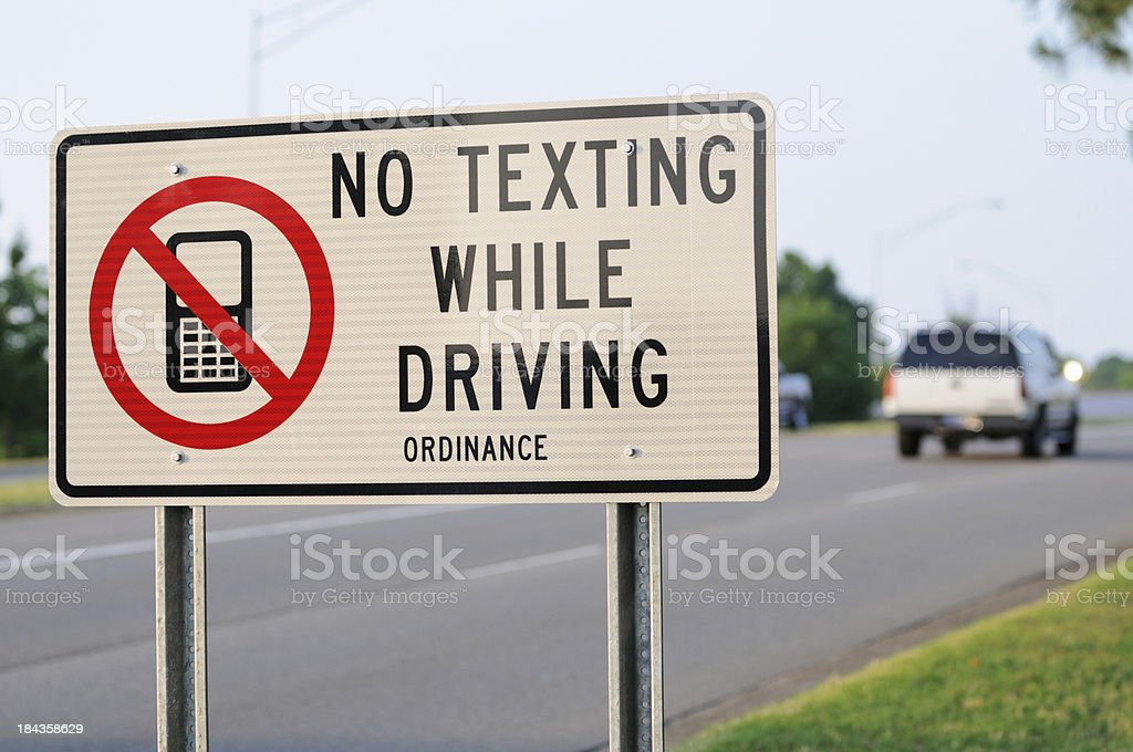 No texting while driving ordinance sign stock photo