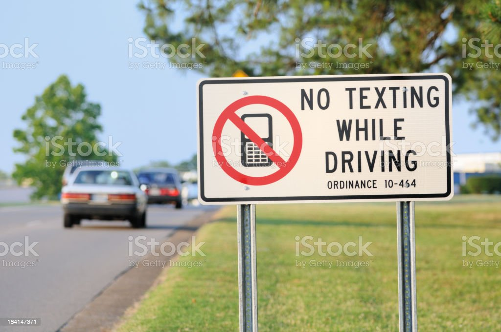 No texting while driving road sign stock photo