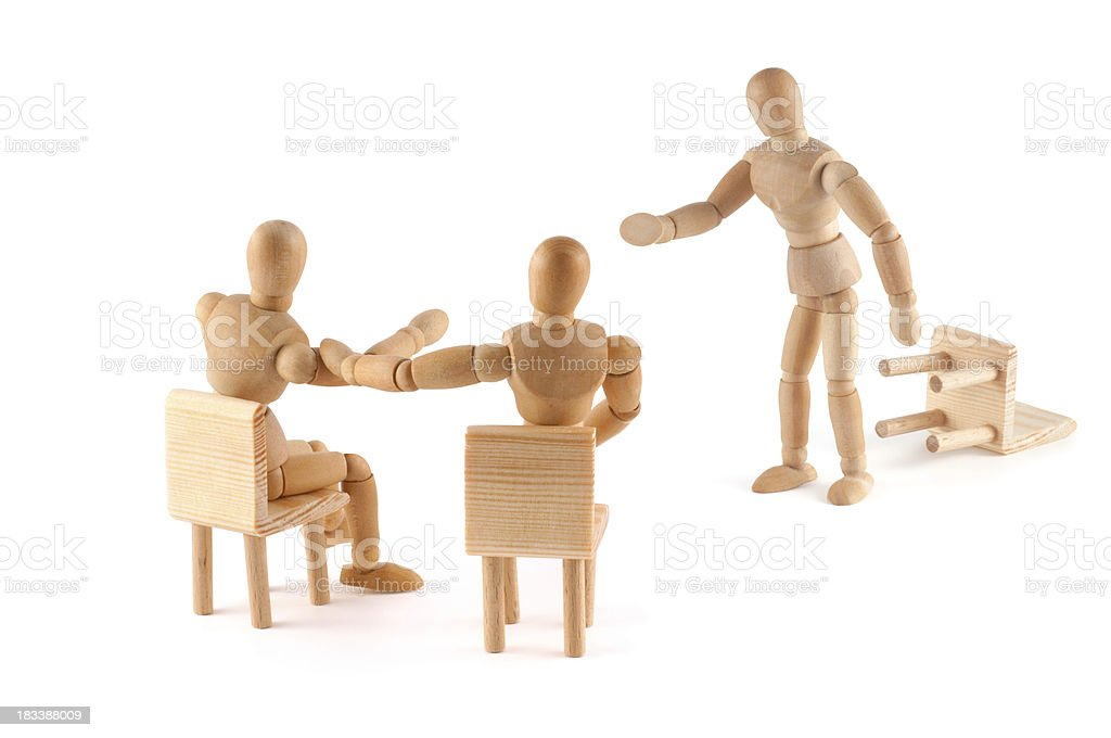 No! This argument is not correct -wooden mannequins in discussion royalty-free stock photo