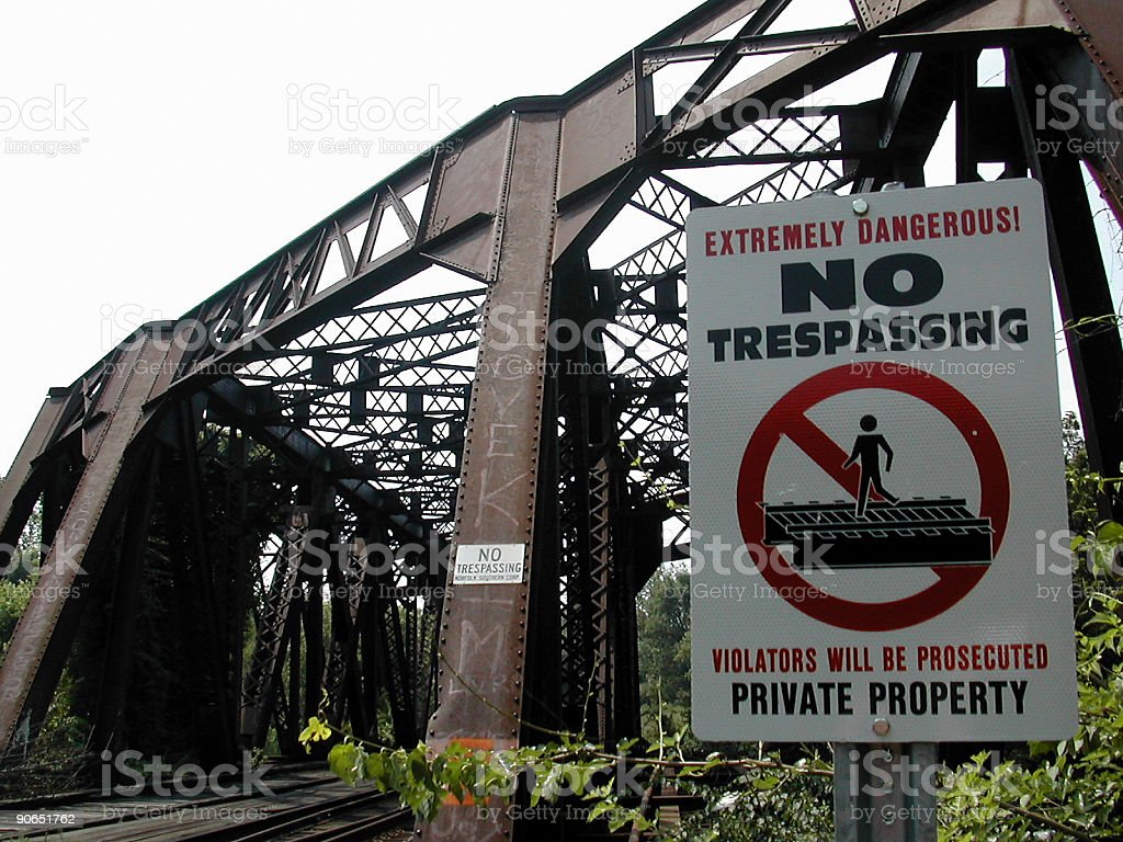 no trespassing over bridge stock photo