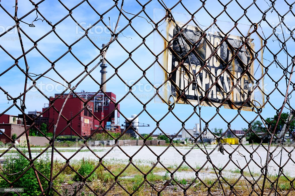 No Trespassing sign, chainlink fence stock photo