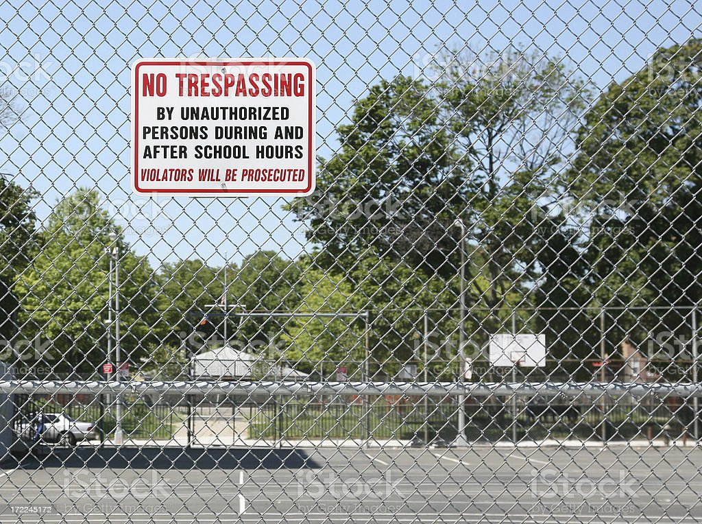 No Trespassing Sign On Fence royalty-free stock photo