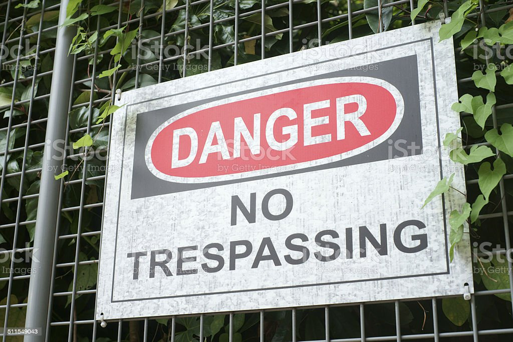 No trespassing sign on the fence stock photo