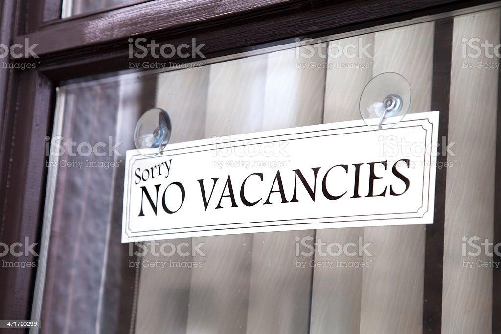 No Vacancies Sign in Window stock photo