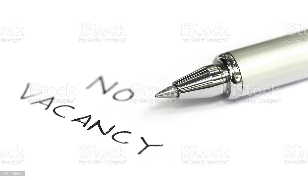No vacancy written on a white paper stock photo