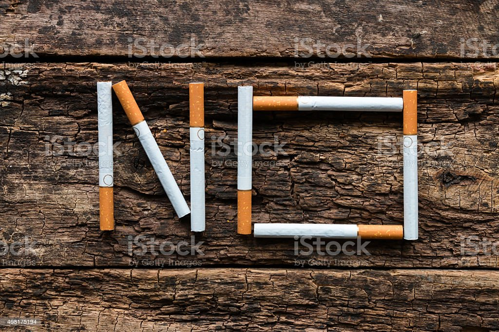 No word of a cigarette on a wooden background stock photo