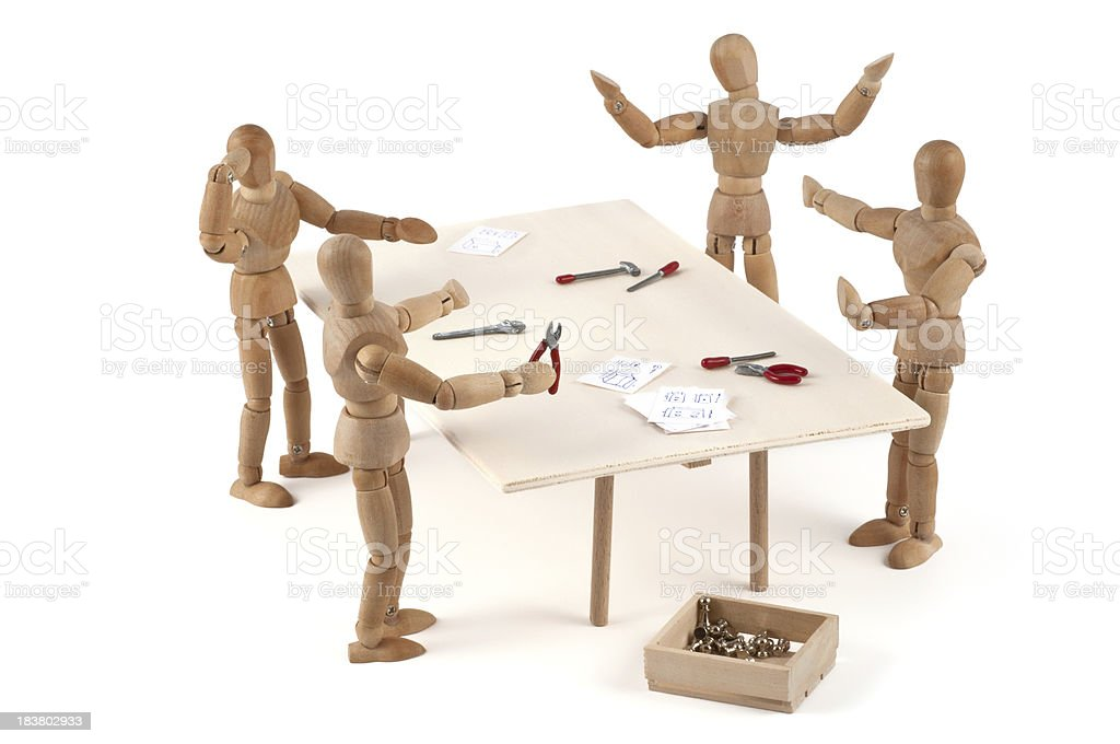 No! You! Me? - wooden mannequin production team in discussion stock photo