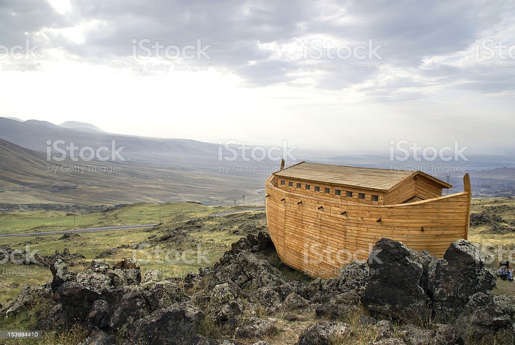 Noah's Ark docked on rocks overlooking a landscape stock photo