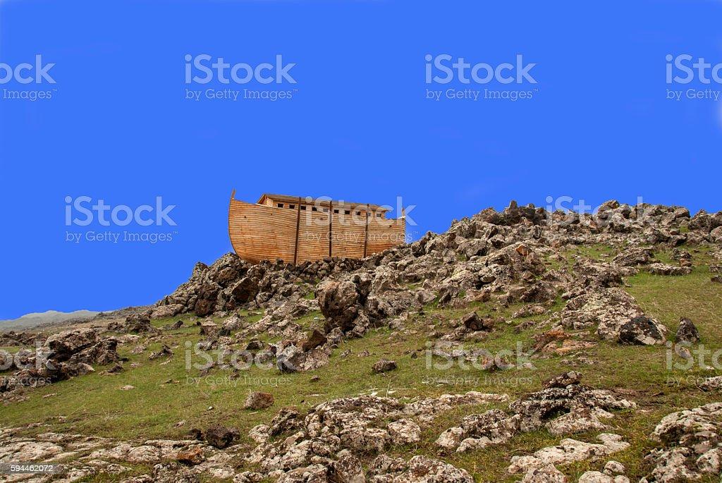 Noah's Ark docked on rocks stock photo