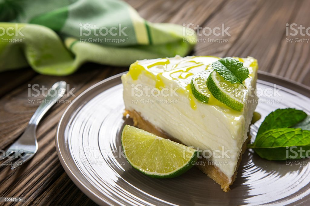 No-bake cheesecake with lime, mascarpone, whipped cream and mint stock photo