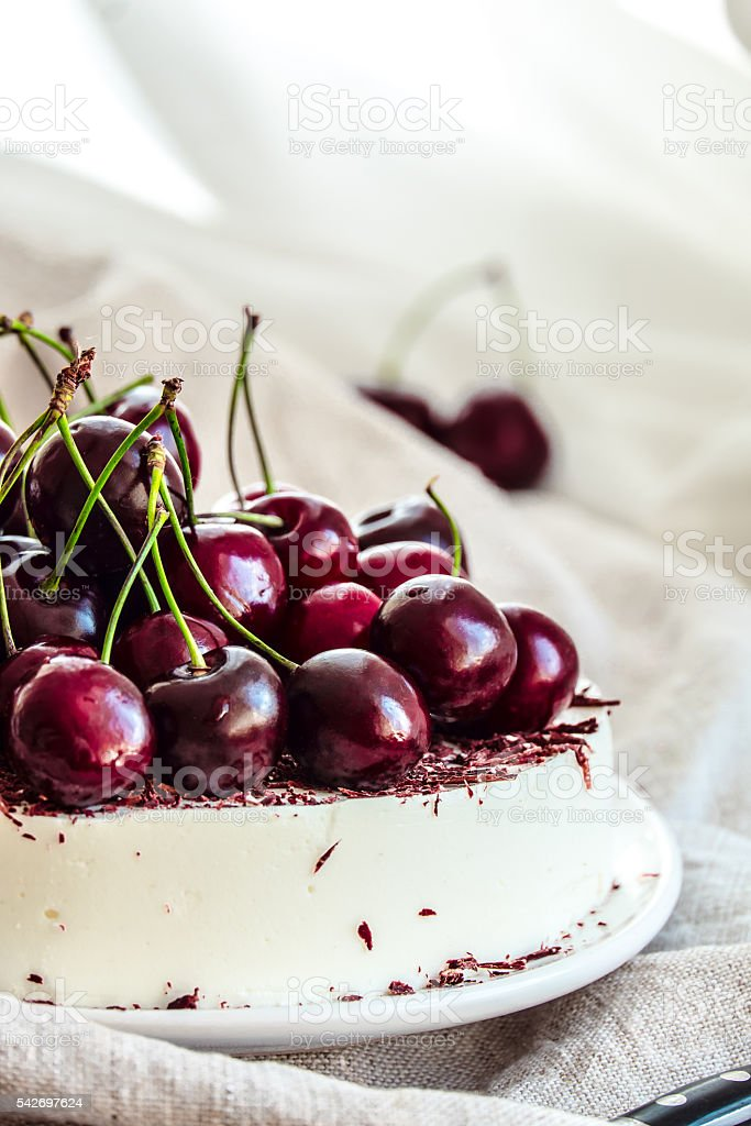 No-bake vanilla cheesecake mousse with cherries and dark chocolate stock photo