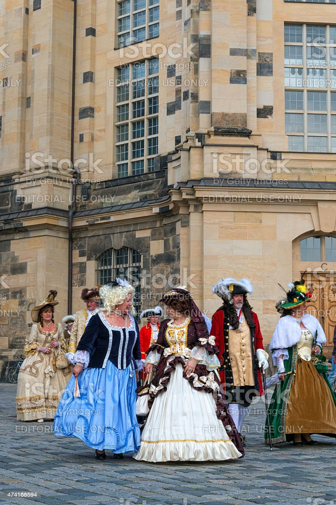 noble ladys in baroque clothes walking trough Dresden stock photo