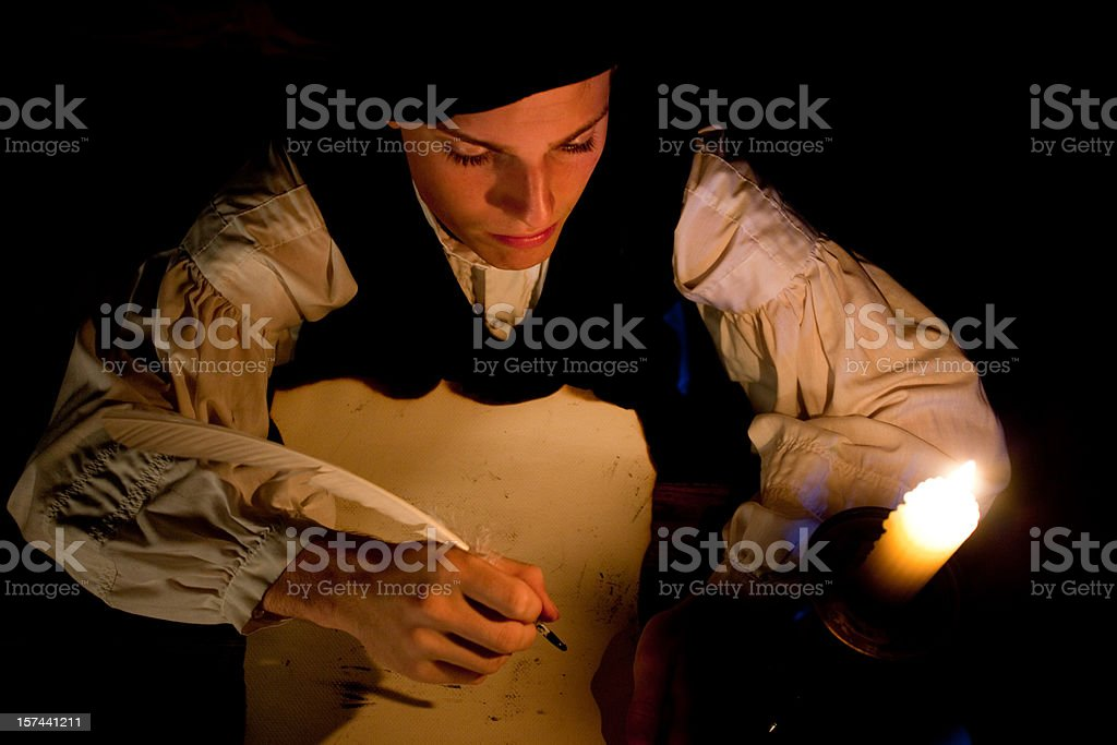 Nobleman working at his desk stock photo