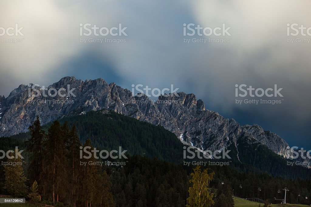 Nocturnal mountain clouds stock photo