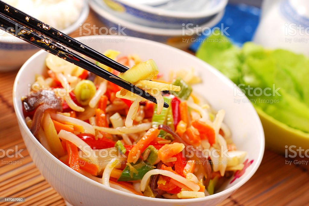 Noel of fresh Chinese stir fry with chopsticks royalty-free stock photo