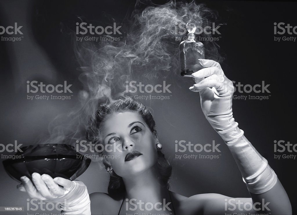 Noir style.Love potion is ready! stock photo