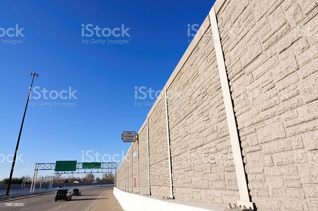 A noise barrier between carriageways stock photo