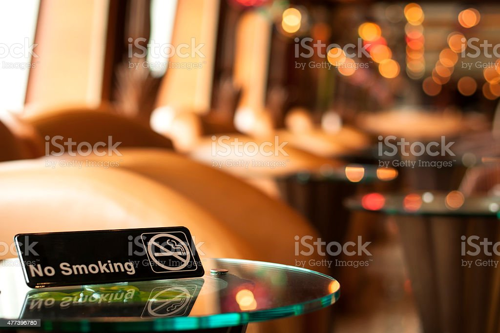 Non smoking sign on a table in a cafe stock photo