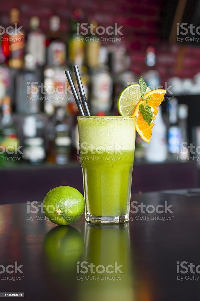 non-alcoholic lime mint orange juice on the  black bar table royalty-free stock photo