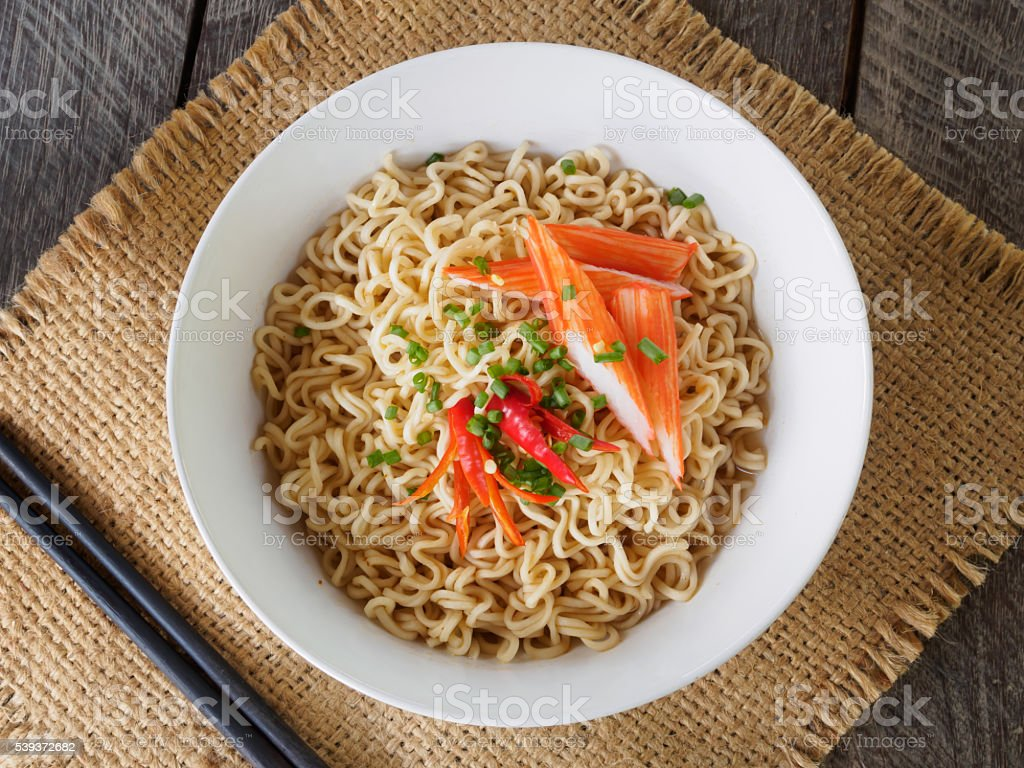 Noodle and crab stick  in white bowl of top view stock photo