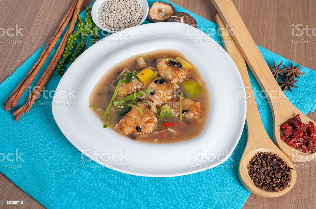 Noodle in fried bean fish with decoration stock photo
