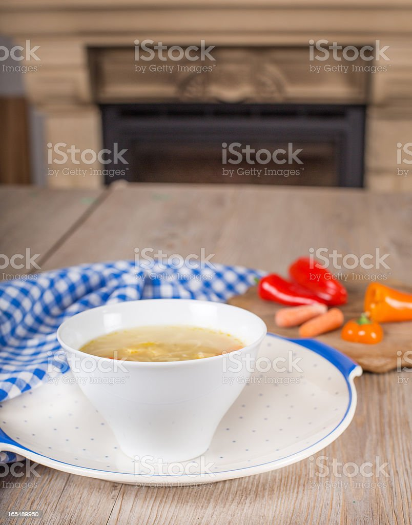 Noodle soup with carrots and vegetables in white bowl royalty-free stock photo